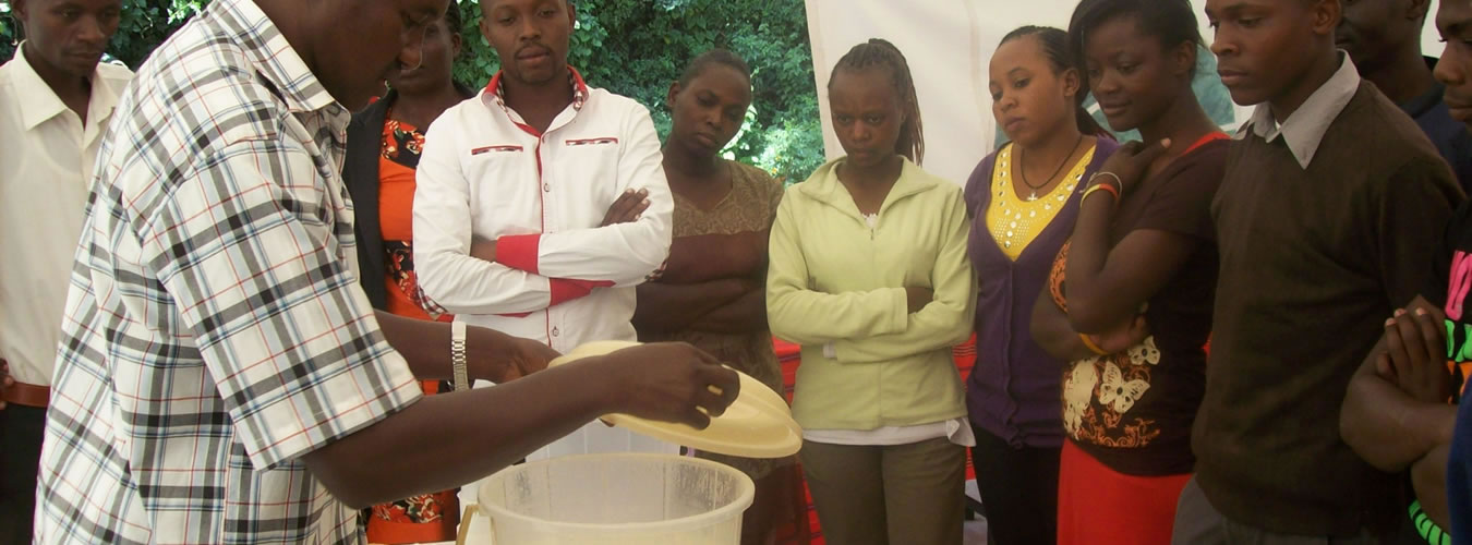 AnthonyInstructor-from-the-Ministry-of-Agriculture-demonstrates-yoghurt-making.-NEFSALFCourse-May-2013
