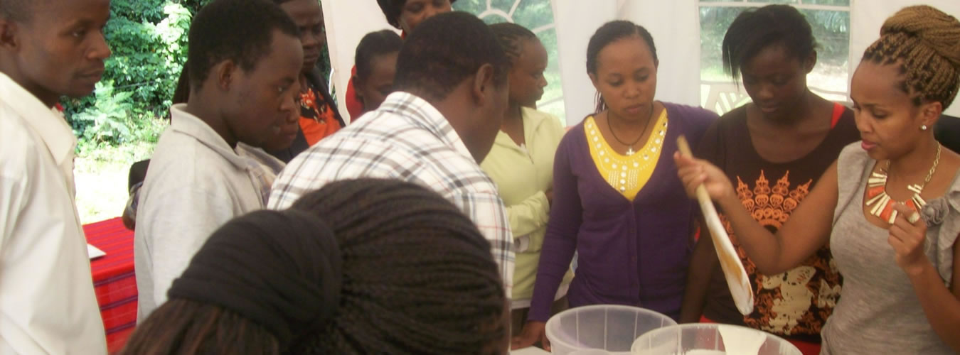 Esther-a-youth-trainee-practices-making-yoghurt-during-NEFSALF-course-May-2013